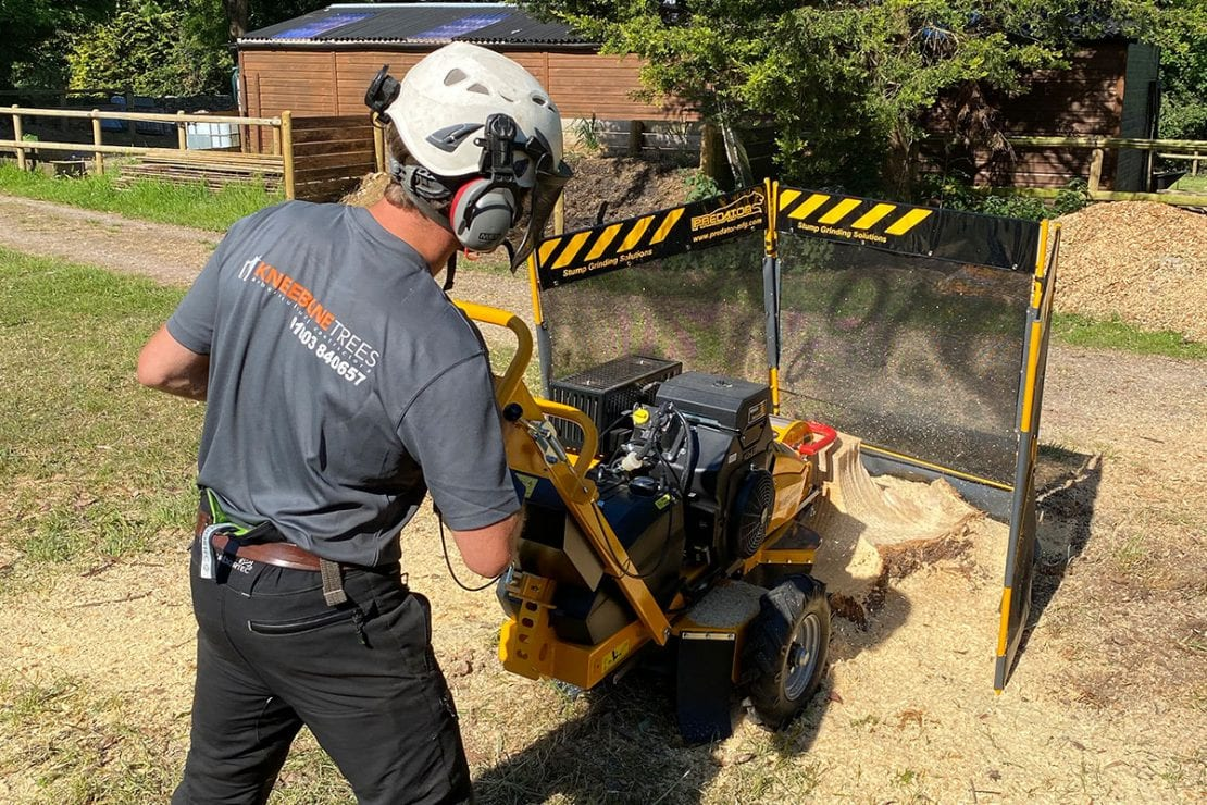 Kneebone tress with all safety equipment whilst stump grinding